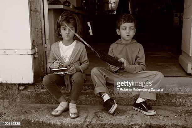 Kids sitting serious playing