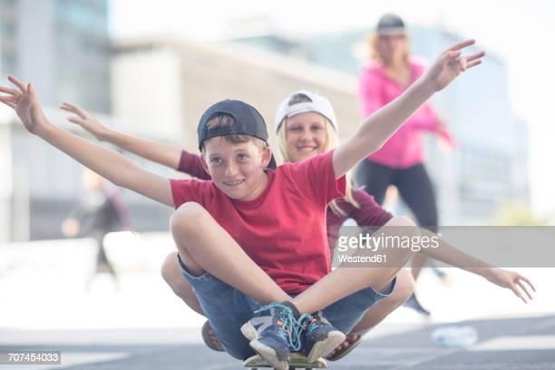 Kids skateboarding in the street