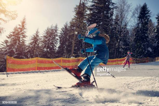 Kids skiing on a beautiful winter day