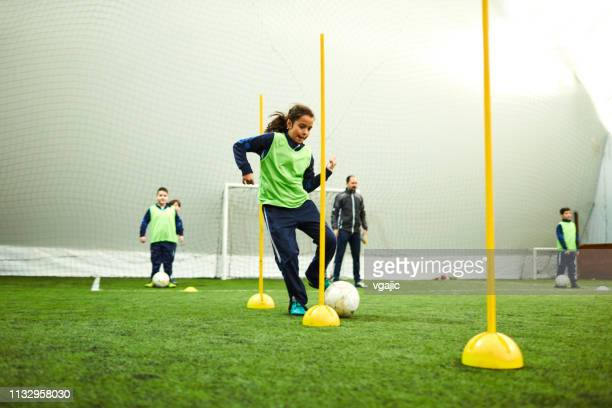 kids soccer - cone shape stock photos and pictures