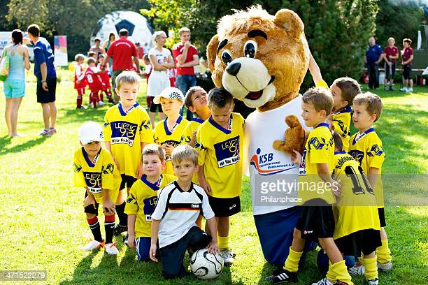 kids soccer team with mascot