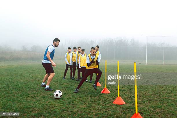 kids soccer training. - cone shape stock pictures, royalty-free photos & images