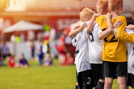 Kids Sport Team Gathering. Children Play Sports. Boys in Sportswear Jersey Uniforms Having Shout Team. Youth Sports For Children. Youth Football Academy Background with Copy Space 1152377000