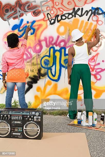 Kids spraying graffiti