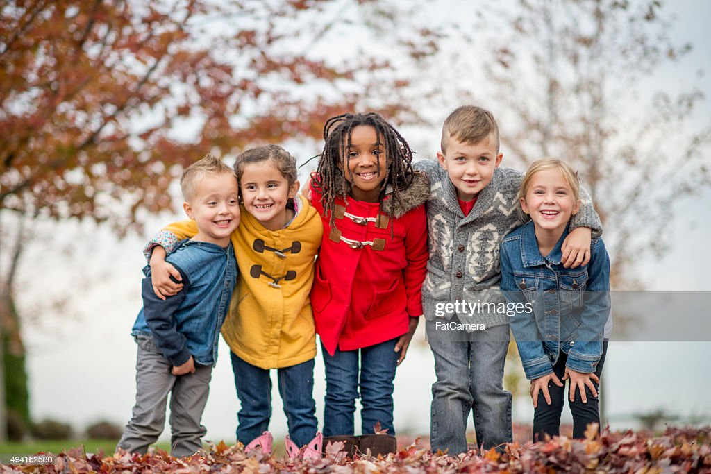 Kids Standing Together in a Row at the Park : Stock Photo