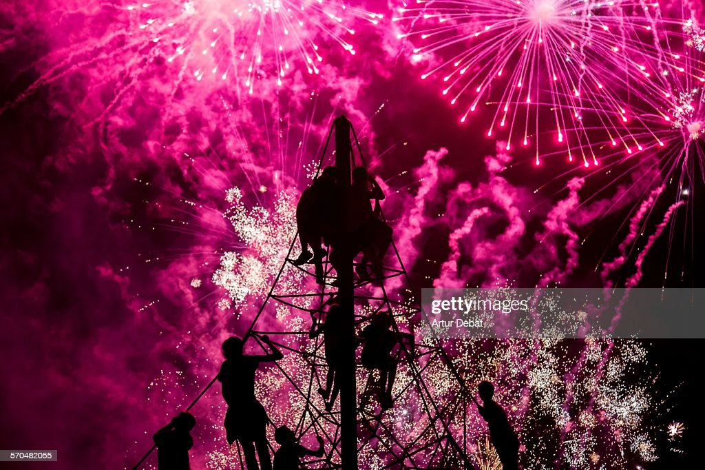 Kids staring the colorful fireworks on summertime : Stock Photo