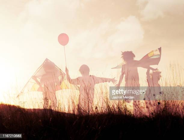 kids sunset silhouette - memories stock pictures, royalty-free photos & images