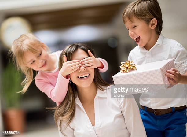 kids surprising mom on mother's day - mother's day stock pictures, royalty-free photos & images