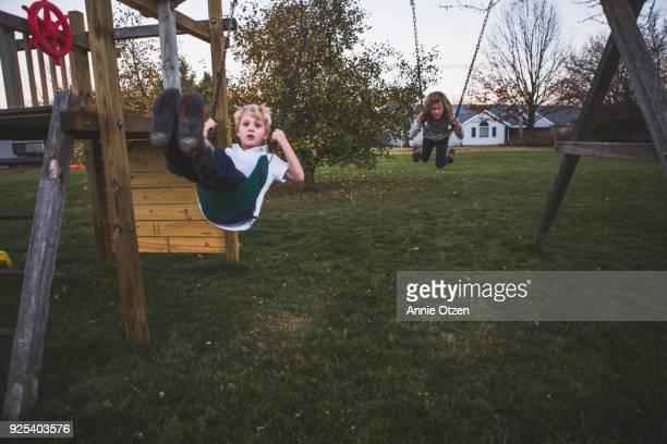 Kids Swinging on Backyard Jungle Gym