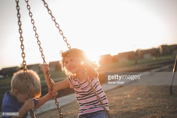 Kids swinging together