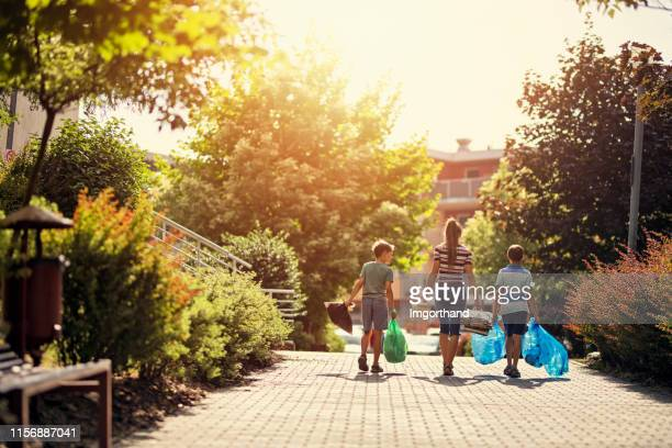 Kids taking out the segregated garbage