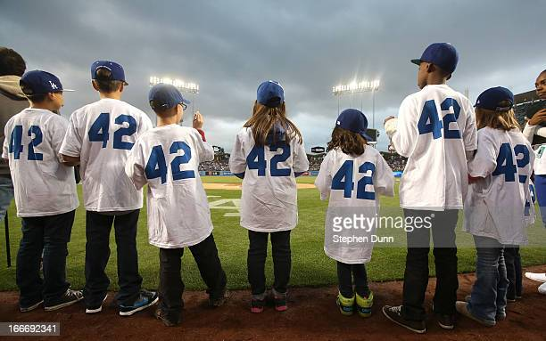 Kids taking part in Jackie Robinson Day ceremonies wear jerseys with the number 42 before the game between the San Diego Padres and the Los Angeles...