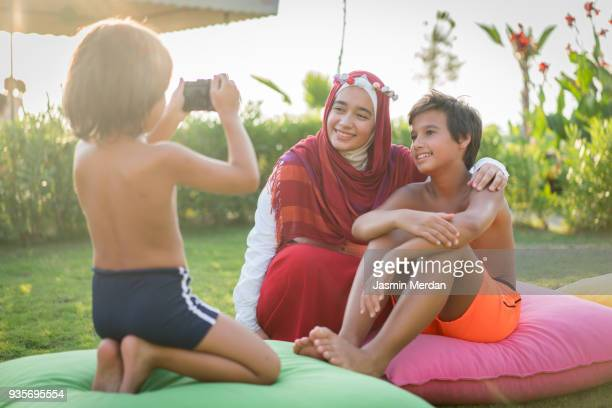 Kids taking photos with camera