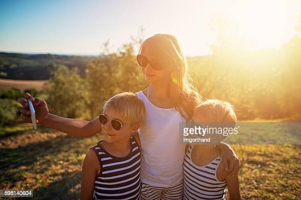 Kids taking selfie in Tuscany, Italy