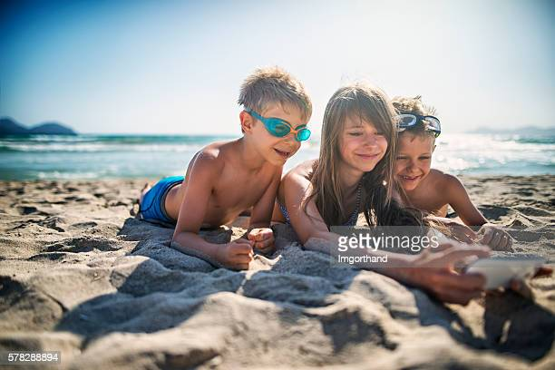 Kids taking selfie on the beach
