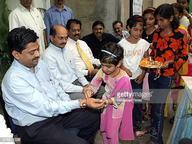 Kids tie Rakhi to Prof Ratnakar Shetty of MCA and others veteran cricketers at Raksha Bandhan festival in Mumbai on Friday