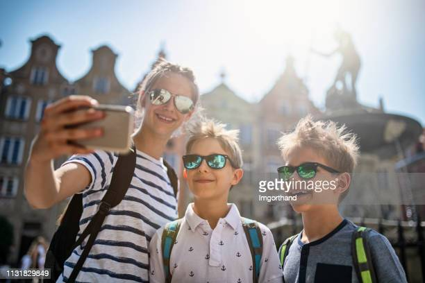 kids tourists sightseeing city of gdansk, poland - imgorthand stock photos and pictures
