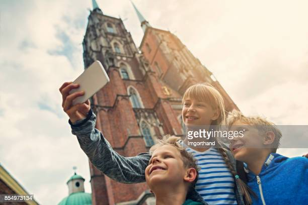 Kids tourists sightseeing city of Wroclaw