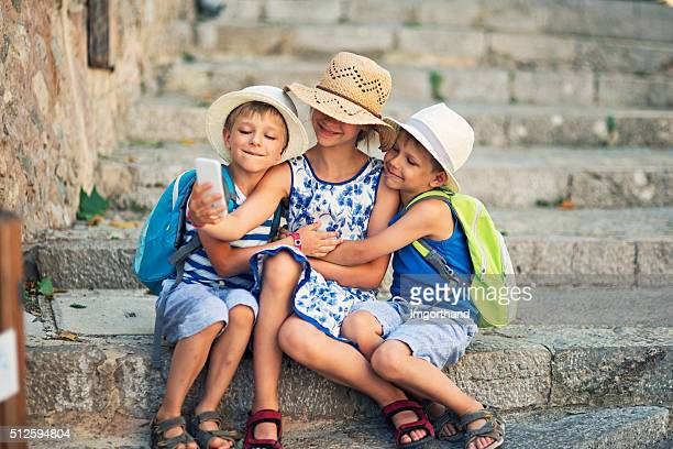 Kids tourists taking selfie