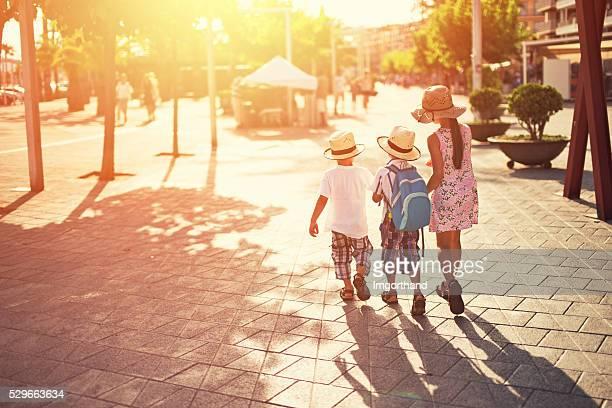 Kids tourists visiting mediterranean town.