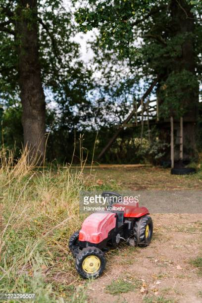 kids tractor outside - kamperen stock pictures, royalty-free photos & images