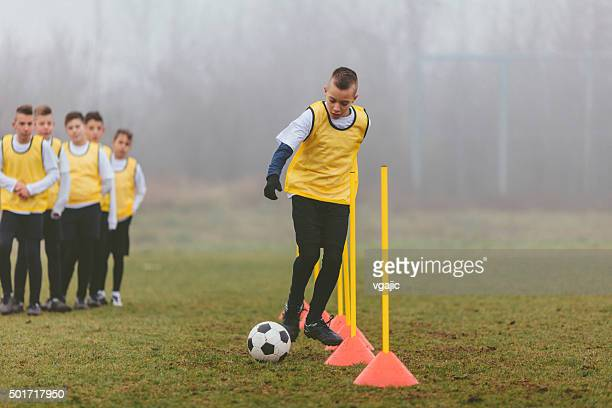 kids training soccer dribbling. - dribbling sports stock pictures, royalty-free photos & images