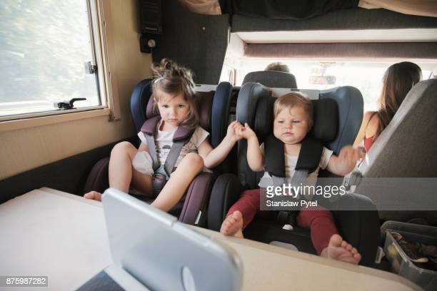 Kids traveling in campervan, watching cartoons