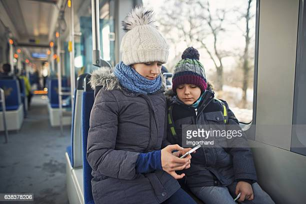 Kids travelling by public transport