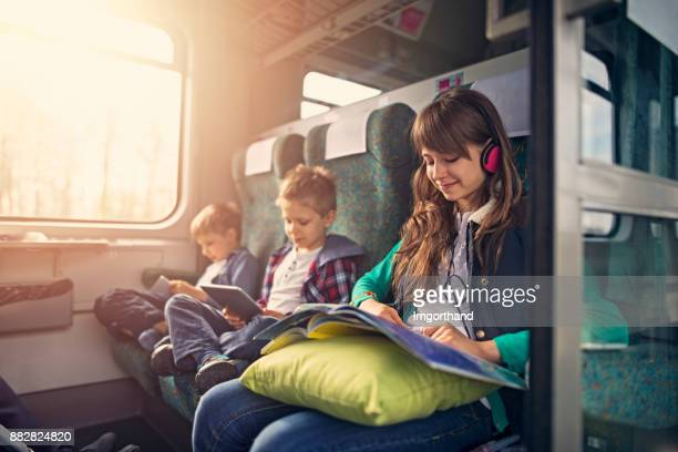Kids travelling by train