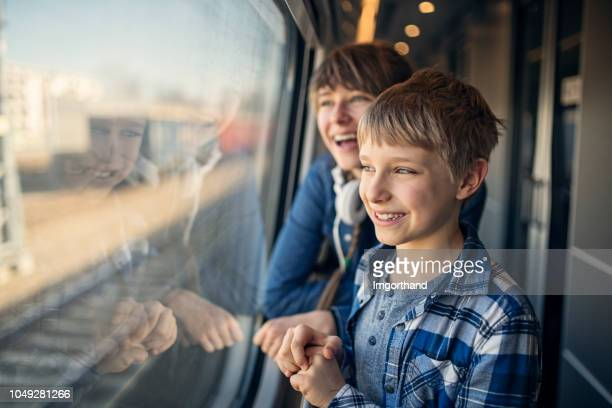 kids travelling on train - public transport stock pictures, royalty-free photos & images