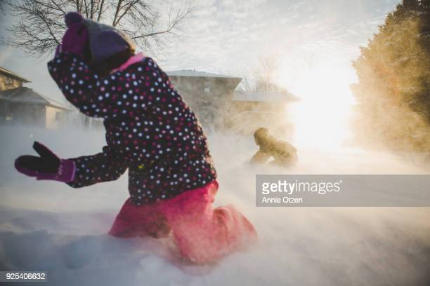 Kids Trying To Play Outside in the Snow