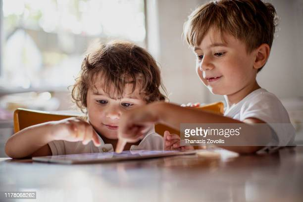 kids using a digital tablet - education stock pictures, royalty-free photos & images