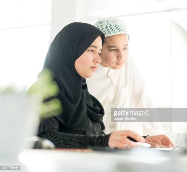 Kids using laptop for online learning