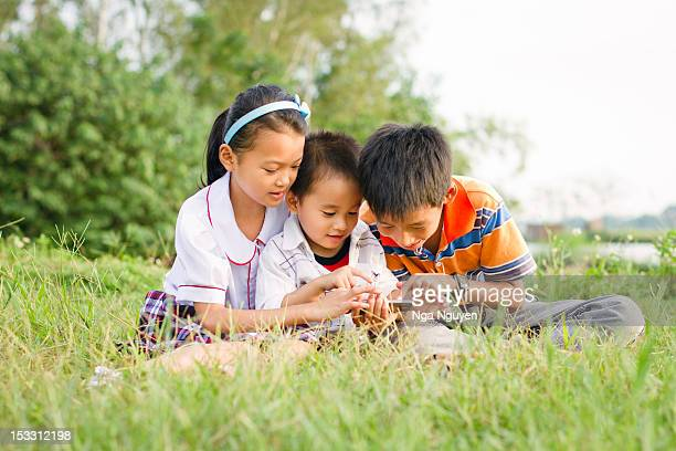 Kids using smartphone outdoor