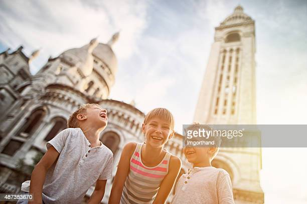 Kids visiting Paris, Sacre Coeur is visible in the background.