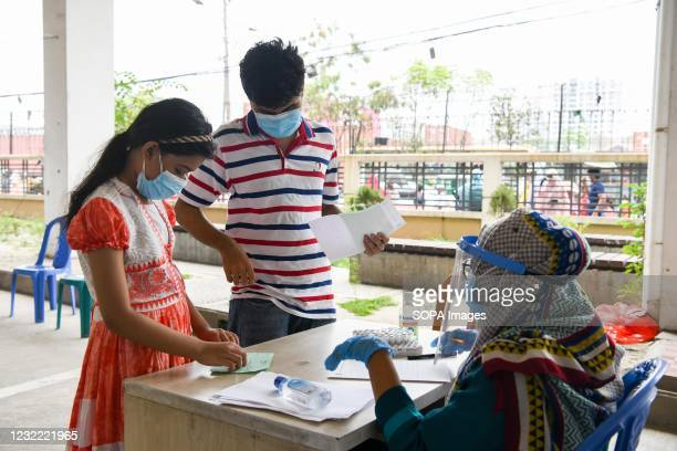 Kids wait inside Mugda Medical College Hospital to get tested for the COVID-19 coronavirus. Bangladesh extends nationwide lockdown measures until...