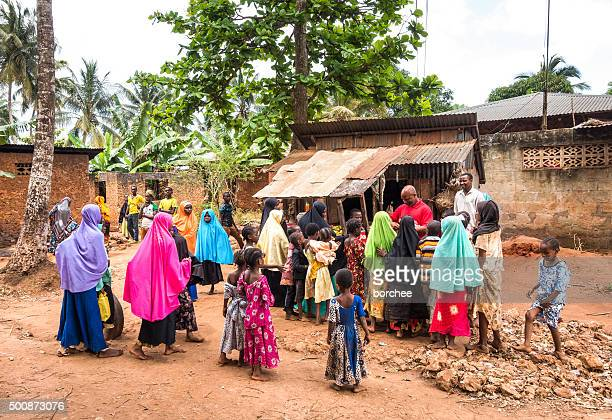 kids waiting for sweets - native african girls stock photos and pictures