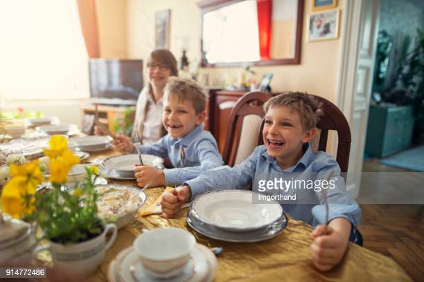 Kids waiting for traditional easter breakfast