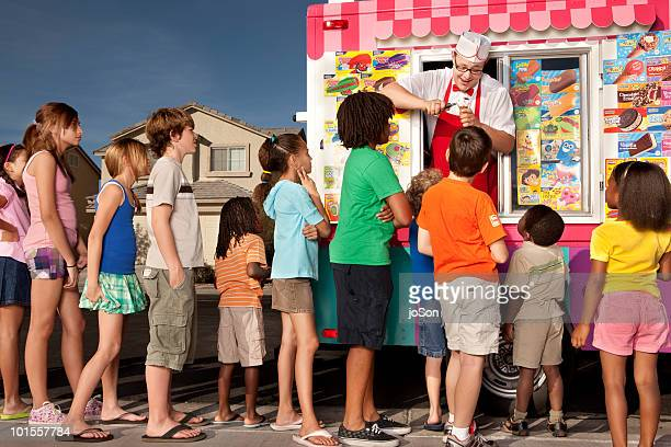Kids waiting in line while ice cream vendor makes