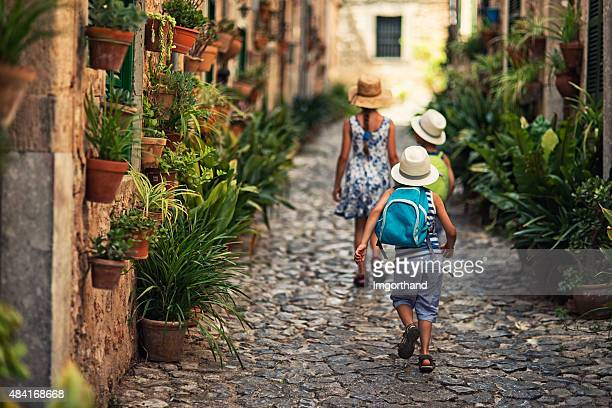 kids walking in mediterranean street. - majorca stock pictures, royalty-free photos & images