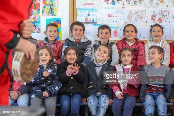 Kids watch as performers wearing Hacivat and Karagoz costumes perform in Van Turkey on February 7 2019 Theater team of Van Ipekyolu Municipality...