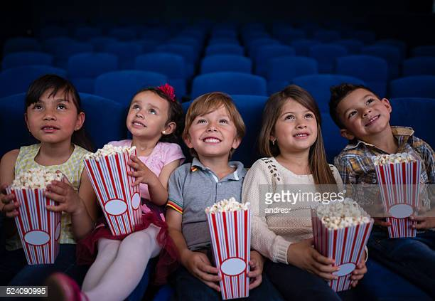 kids watching a movie - children theatre stock photos and pictures