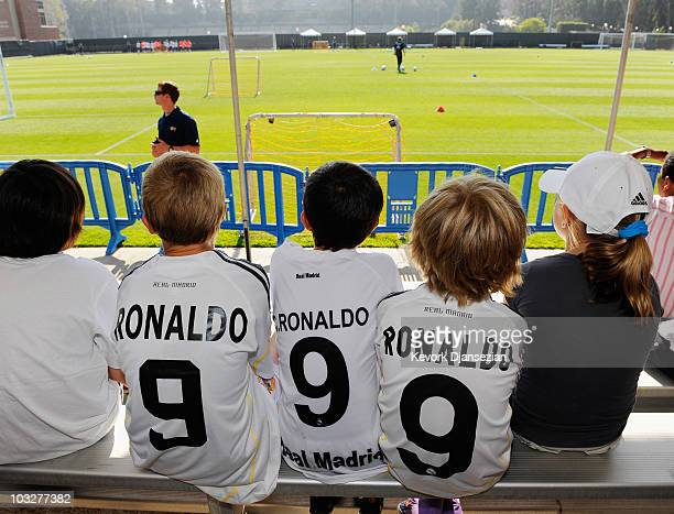 Kids wearing Cristiano Ronlado jersey look at Real Madrid players during training session on the campus of UCLA on August 6 2010 in the Westwood...