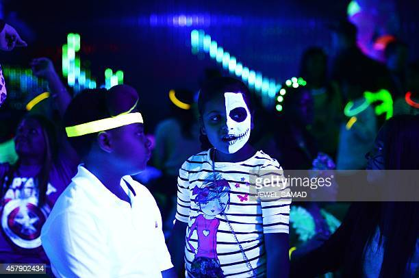 Kids wearing Halloween costumes and makeups join an electronic dance music party organized by CirKiz at a night club in New York on October 26 2014...