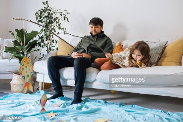 kids with father playing fishing at home - kids pool games stock pictures, royalty-free photos & images