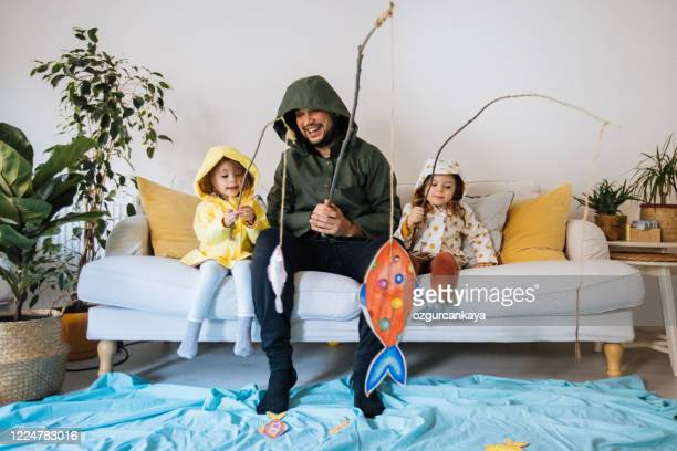 kids with father playing fishing at home - leisure games stock pictures, royalty-free photos & images