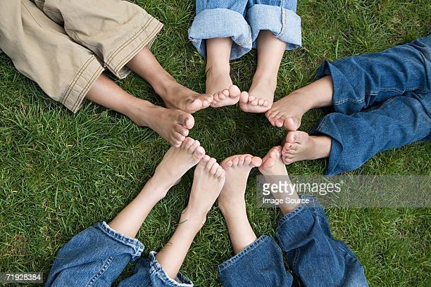 Kids with feet in a circle
