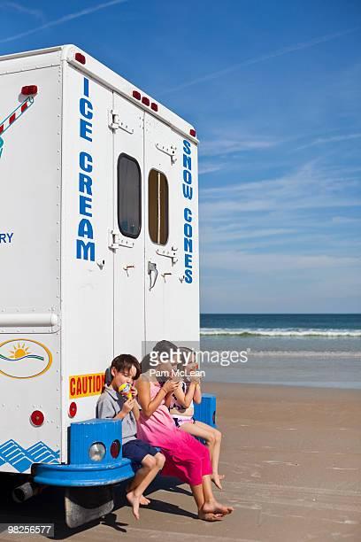 Kids with ice cream truck on beach