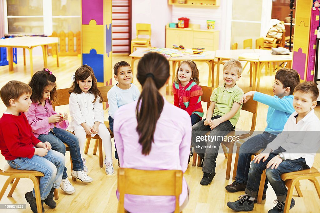 Kids with kindergarten teacher. : Stock Photo