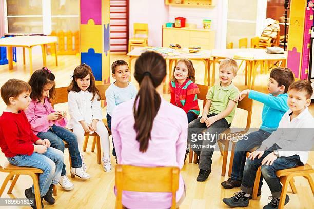 Kids with kindergarten teacher.